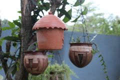 Clay flower pots and clay bird nest royalty free stock photos