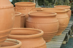Clay flower pots, flower beds, plants for decoration stock photos