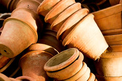 Clay flower pots lying in stacks. These empty flower pots are used to house plants Royalty Free Stock Photography