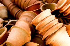 Clay flower pots lying in stacks. These empty flower pots are used to house plants Stock Photo