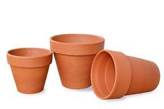 Clay flowerpots isolated on white background. Different sizes royalty free stock image