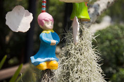 Clay girl doll hanging on the tree. For decoration in garden at outdoor of home Royalty Free Stock Photos