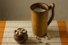 Clay glass with beer and pistachios on the table royalty free stock images
