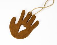 Clay Hand Christmas Ornament. Clay hand Christmas tree ornament with heart in the middle Stock Photo