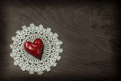 Clay heart on knitted napkin Stock Photo