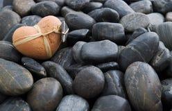 Clay Heart on Stones Stock Photos
