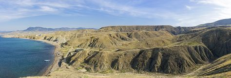 Clay hills and ravines as a result of soil erosion. The foot of Cape Meganom, Crimea. Sunny day in early October stock images