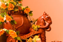 Clay horse with a chariot carrying flowers. Glazed clay horse with a pitcher chariot carrying flowers Stock Photos