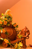 Clay horse with a chariot carrying flowers. Glazed clay horse with a pitcher chariot carrying flowers Stock Images
