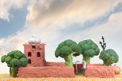 Clay house with broccoli trees Royalty Free Stock Photos