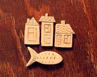 Clay houses and fish Stock Images