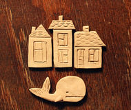 Clay houses and whale Stock Photos