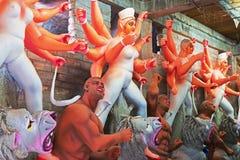 Clay idol of Goddess Durga, Kumartuli, Kolkata, West Bengal, India. Clay idol of Goddess Durga, under preparation for `Durga Puja` festival in Kumartuli, Kolkata Royalty Free Stock Image