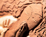 Clay inclined figurine of angel praying macro Royalty Free Stock Photo