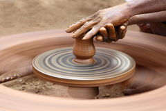 Clay Jar. Earthen jar in the process of making on potter wheel Royalty Free Stock Photos