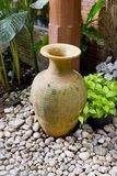 Clay jar in the garden Royalty Free Stock Photo