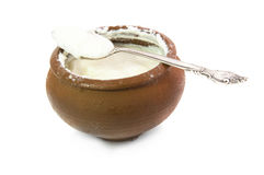 Clay jar with sour cream Royalty Free Stock Photos