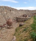 Clay jar, walls and artifacts of the Peristera Fortress in  Bulgaria Royalty Free Stock Photo