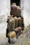 CLAY JARS IN CHINA. Clay or ceramic jars stacked up inside an abandoned wine distillery in China Stock Image