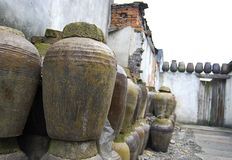 CLAY JARS IN CHINA. Clay or ceramic jars stacked up inside an abandoned wine distillery in China Stock Photos