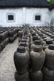 CLAY JARS IN CHINA. Clay or ceramic jars lined up inside an abandoned wine distillery in China Stock Photography