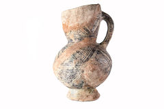 Clay jug. Clay old Middle Eastern jug on the white background Royalty Free Stock Photos