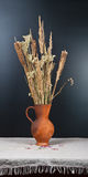 Clay jug with a bouquet Royalty Free Stock Photo
