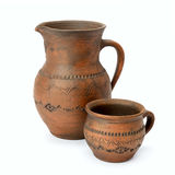 Clay jug and cup isolated on white Royalty Free Stock Image