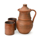 Clay jug and cup isolated on white Stock Image
