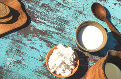 Clay jug, a cup of milk, cottage cheese and bread on a table of Royalty Free Stock Image