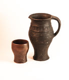 Clay jug and cup Royalty Free Stock Photos