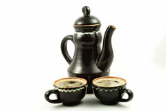 Clay jug and cups filled with pottery royalty free stock photo