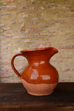 Clay jug in front stone wall Stock Image
