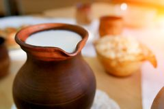 Clay jug of milk on the table . Organic food royalty free stock photos