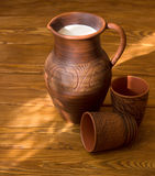 Clay jug with milk Royalty Free Stock Photography