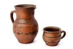 Clay jug and mug Royalty Free Stock Photos