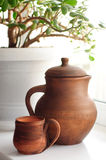 Clay jug and mug Royalty Free Stock Photos