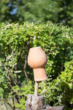 Clay jug on a stick Stock Photography