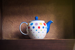 Clay jug and three cups of milk Royalty Free Stock Images