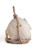 Clay Jug and Twig Birdhouse. Cream colored birdhouse jug partially wrapped in a twig holder held together with leather straps. white background, profile view royalty free stock photos