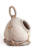 Clay Jug and Twig Birdhouse. Cream colored birdhouse jug partially wrapped in a twig holder held together with leather straps. white background, angular view royalty free stock images