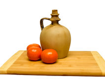 Clay jug on a wooden board Royalty Free Stock Images