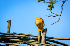 Clay jug on wooden fence Stock Photo