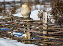 Clay jug on wooden fence in winter Stock Images