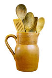 Clay Jug and Wooden Spoons. On isolated white background with a clipping path Stock Image