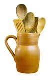 Clay Jug y cucharas de madera Imagen de archivo