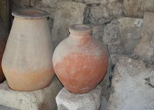 Clay jugs on the background of a stone wall. royalty free stock photo