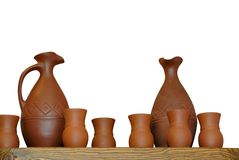 Clay jugs cups isolated on white Stock Image