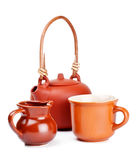 Clay kettle and cup Stock Photo