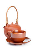 Clay kettle and cup. Isolated on white Royalty Free Stock Photos